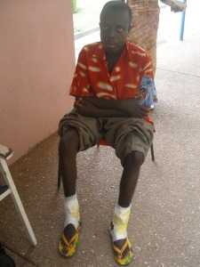 Domfe's sickle cell gave him chronic leg ulcers.  The disease also prompted his family to abandon him.