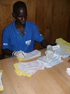 Dr. Frempong's staff, like Isaac, catalog the blood samples before they are sent to a lab in Accra for analysis.